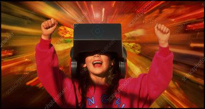 Girl with virtual reality headgear