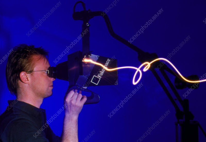 Man using the Fake Space virtual reality system