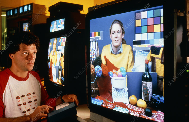 Scientist demonstrating high-definition TV system