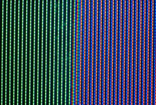 Close-up of coloured strips making up a TV image