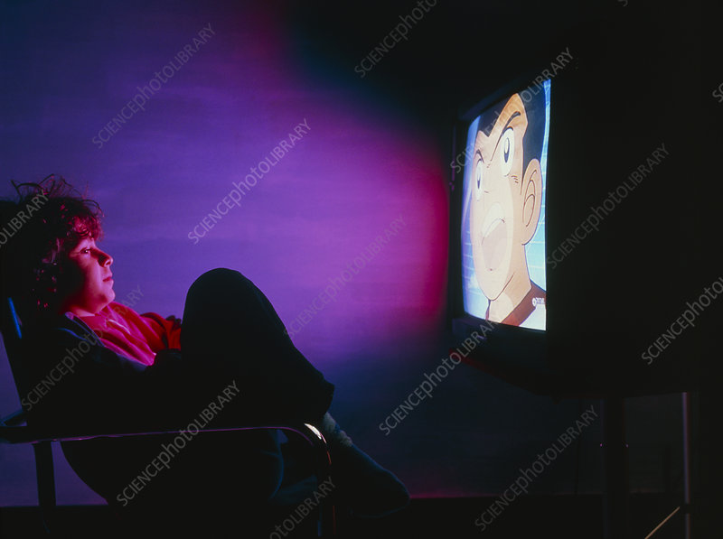 Child watching cartoon character on television