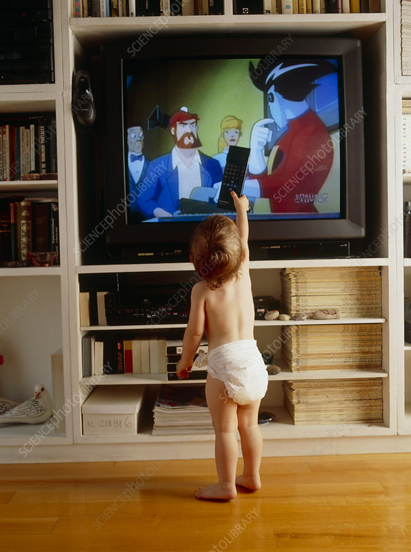 Child watches television using remote control