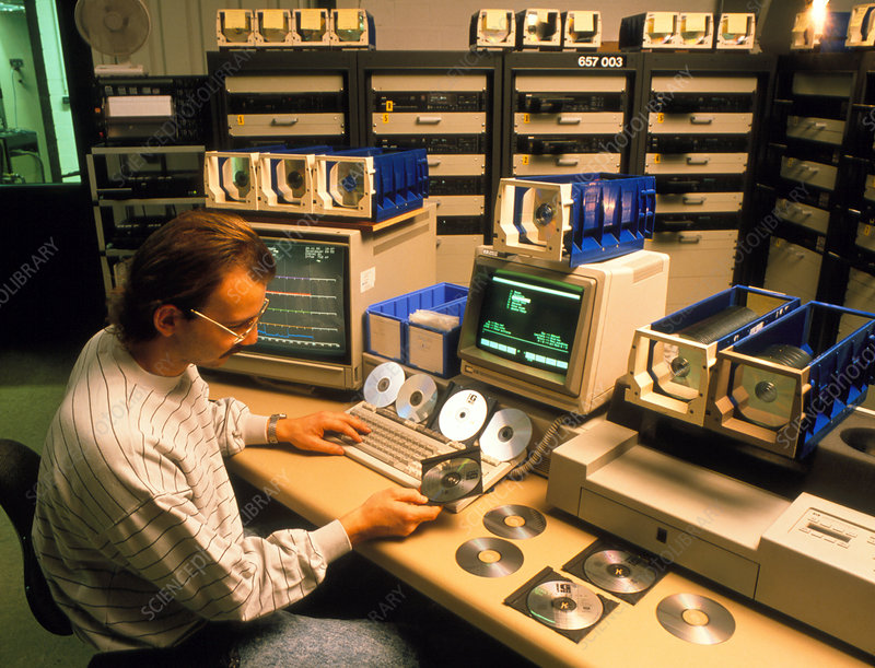 Technician electronically checks compact discs