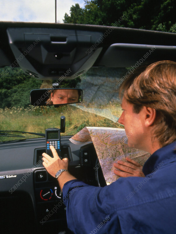 Car driver using hand-held GPS receiver