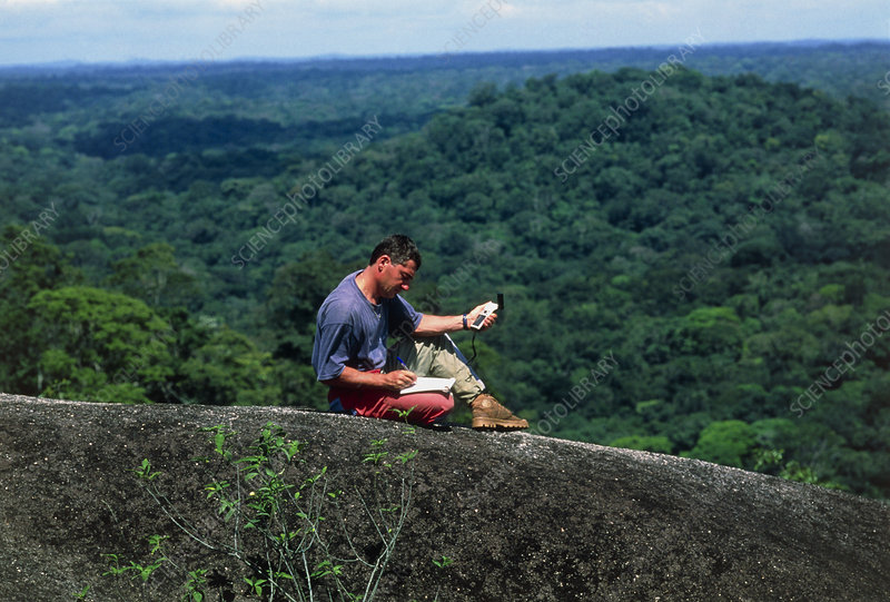 Field biologist using a global positioning system