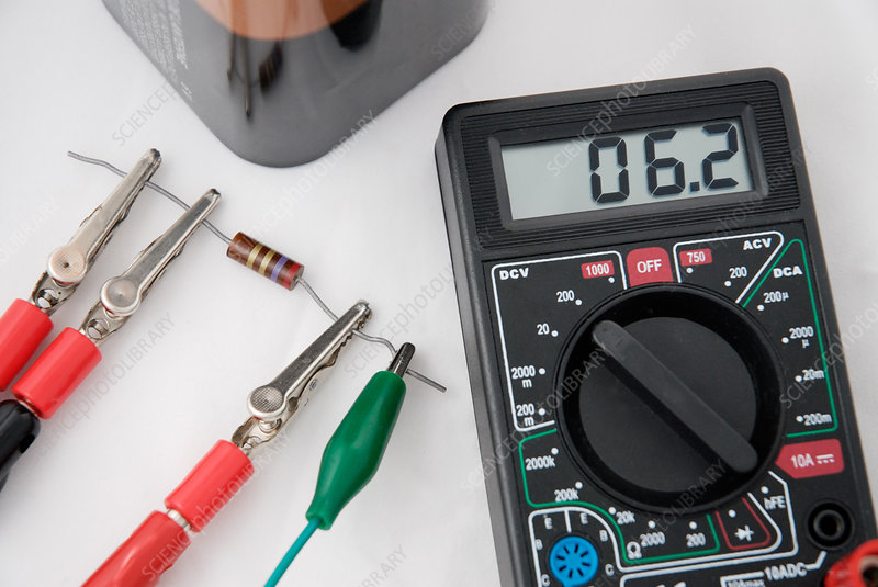 'Digital multimeter, resistor and battery'