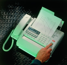 Fax machine transmitting a document