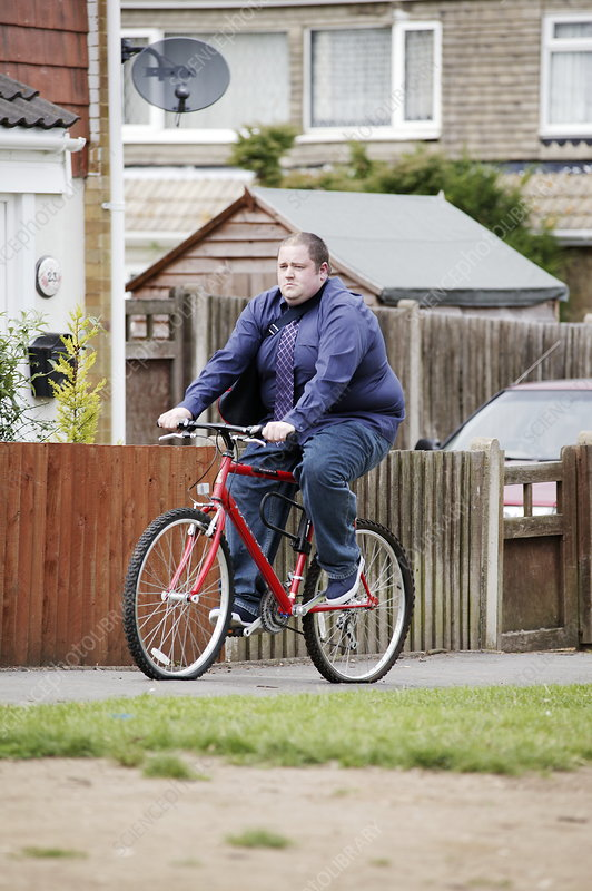 Overweight man cycling