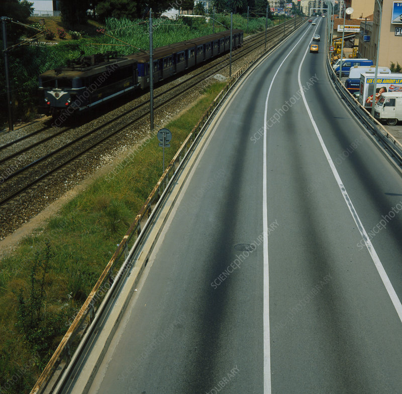 Freeway running alongside a railway