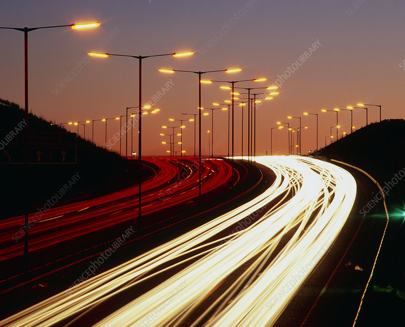 Light trails from vehicles on motorway at night