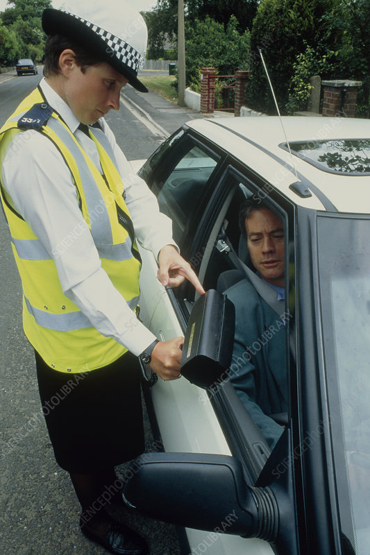 Policewoman showing speed detector to driver