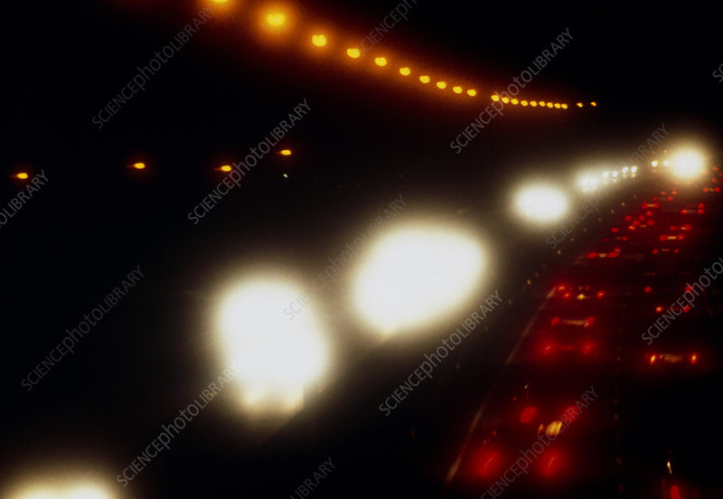 View of vehicles on a motorway at night