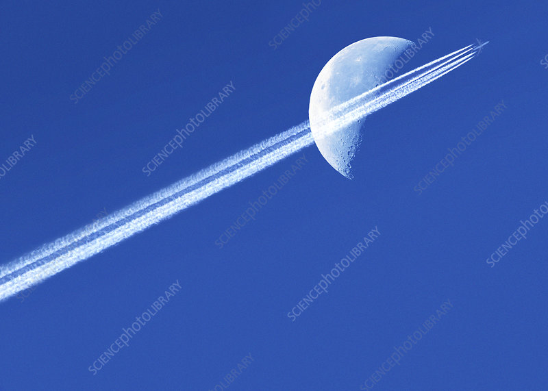 Aeroplane contrail against the Moon