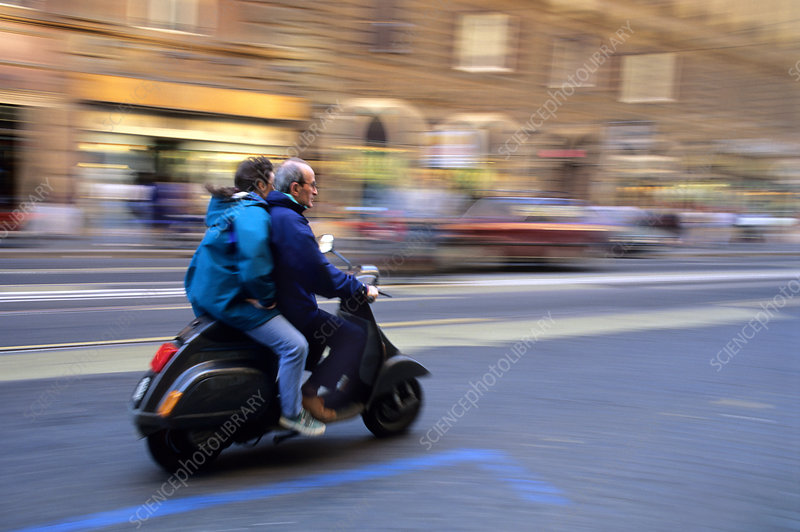 People Riding a Scooter in Rome, Italy