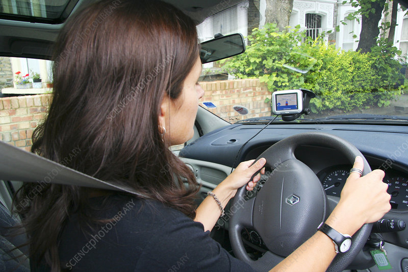 Woman using a satellite navigation system
