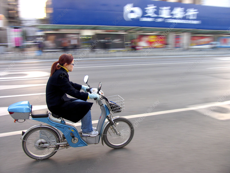 Woman on an electric moped