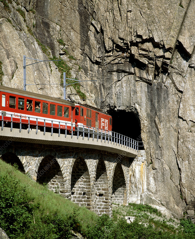 Train and tunnel in a granite gorge, Switzerland