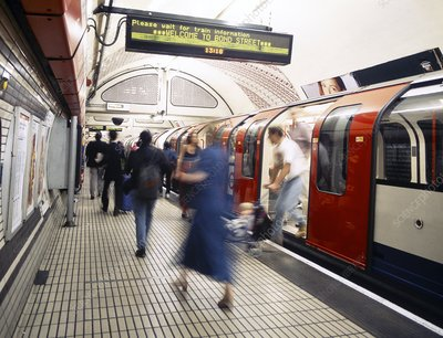 Passengers leaving a London Underground Tube Train