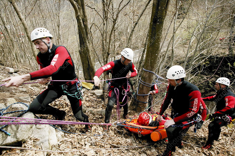 Mountain rescue workers stretchering a casualty