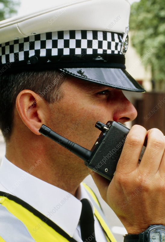 Policeman using walkie-talkie