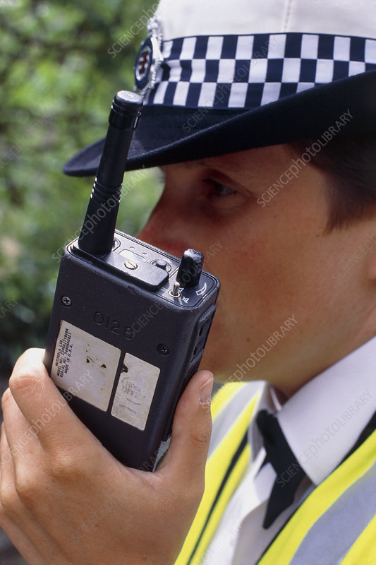 Policewoman using walkie-talkie