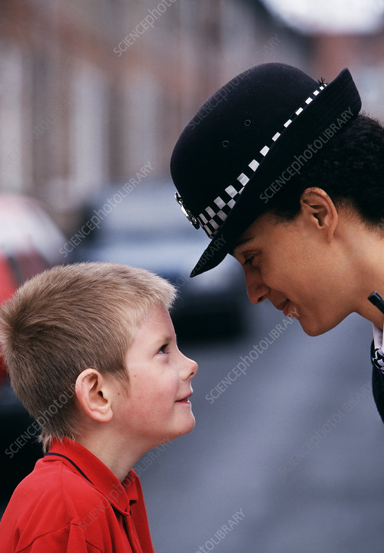 Policewoman and small boy