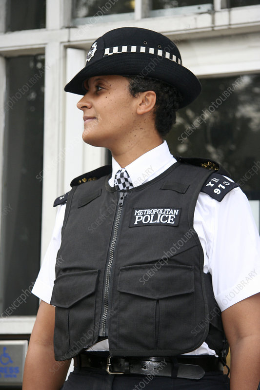 Policewoman wearing body armour