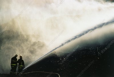 Firefighters extinguishing a ground fire