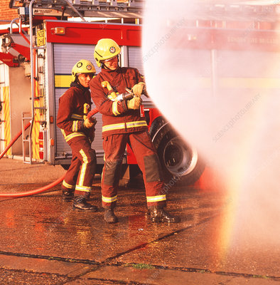 Firefighters using hose
