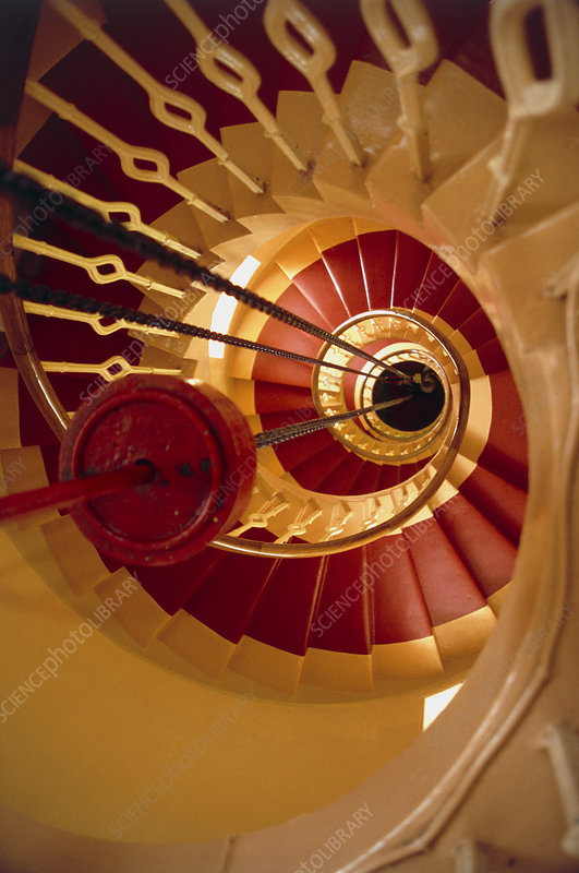 View down lighthouse stairs showing lantern weight