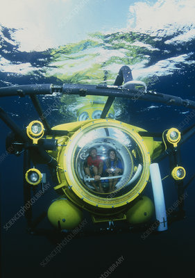 Two oceanographers deep diving in a minisub