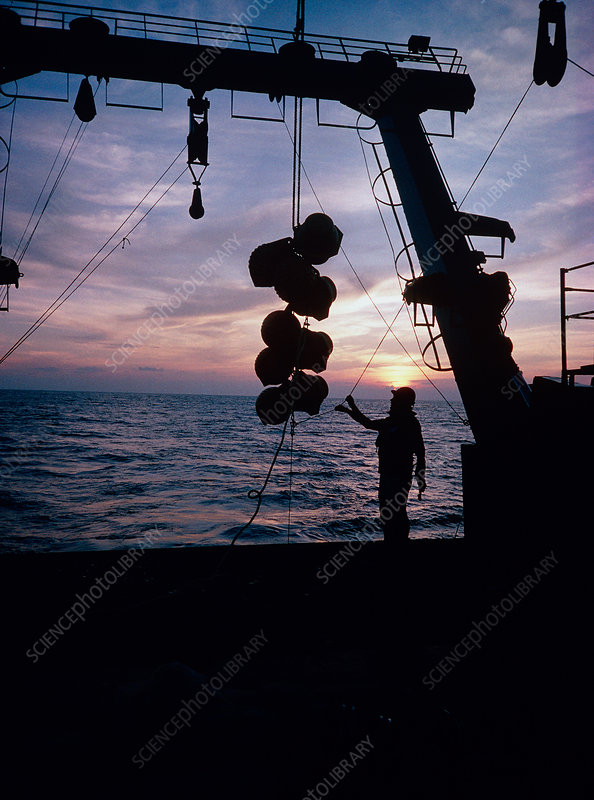 Oceanographer deploying instruments