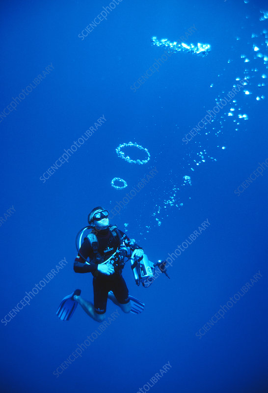 Diver blowing bubbles