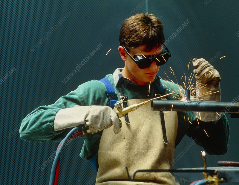 Man welding a pipe using an oxyacetylene torch.