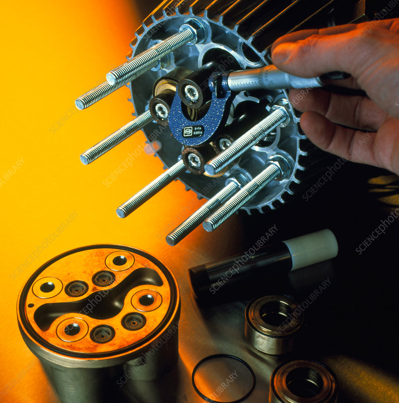 Engineer measures component with micrometer