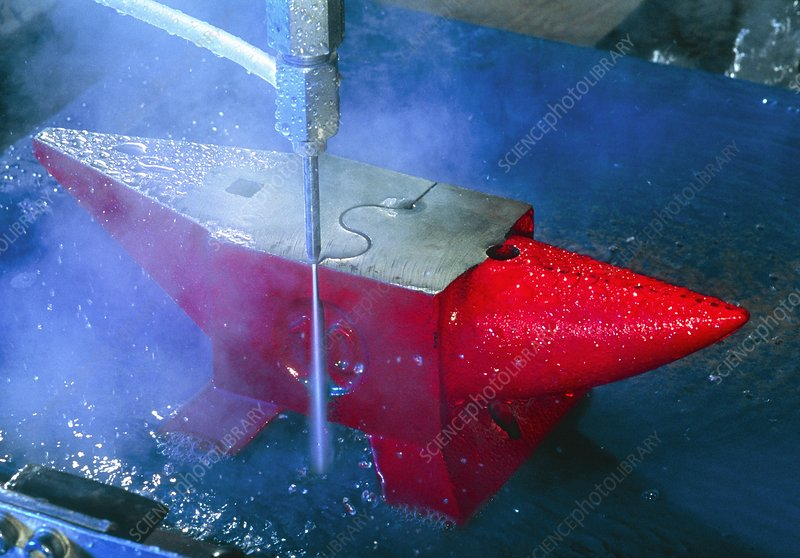 Waterjet cutting through a steel anvil