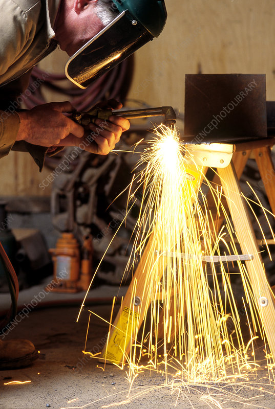 An Acetylene Torch Cutting Steel