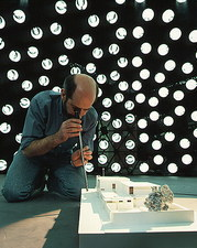Technician examines model under artificial sky