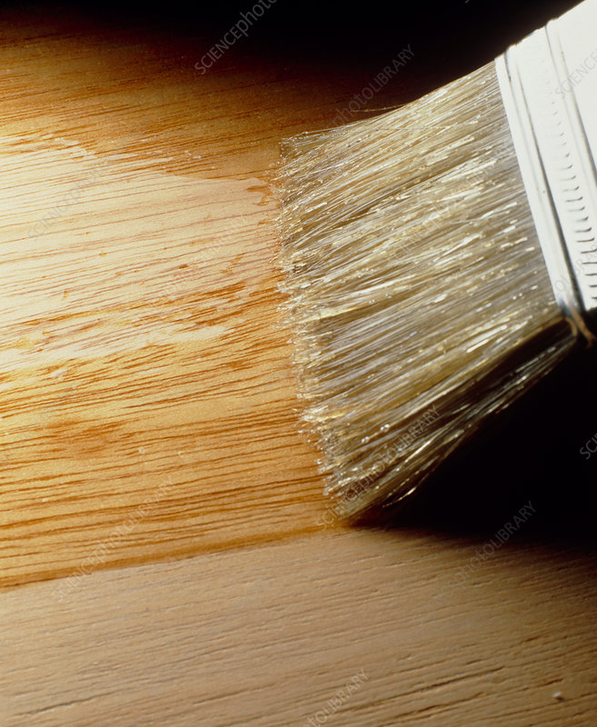 Varnish being brushed onto wooden surface