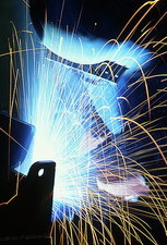 Sparks flying from an argon welder at work