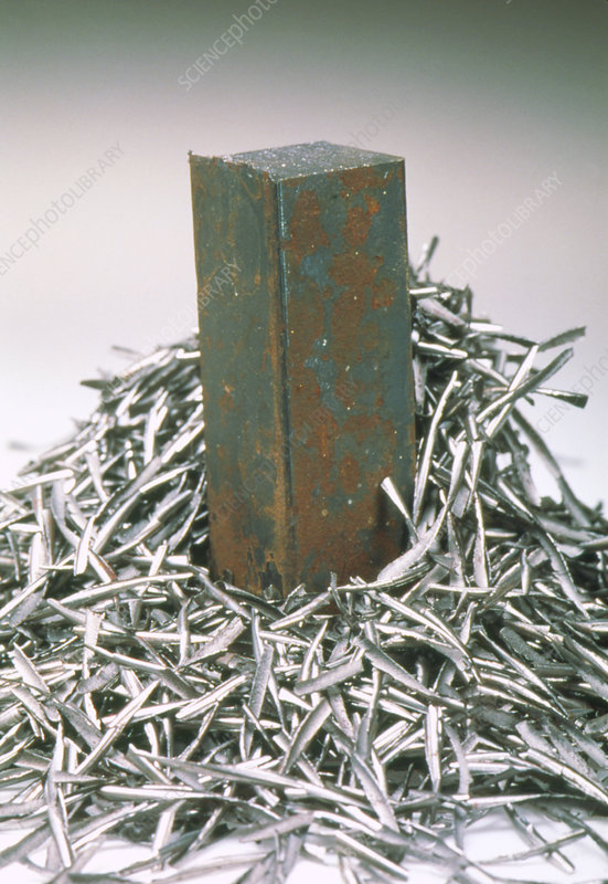 Corroding steel bar with fresh strips of steel