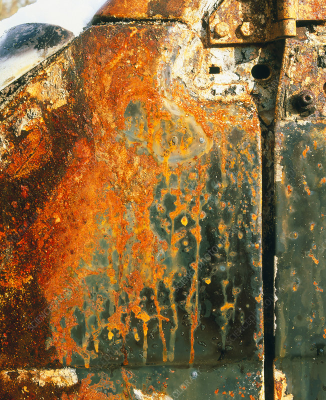View of rust on the door of an abandoned vehicle
