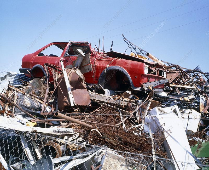 Rusting scrap metal and abandoned car