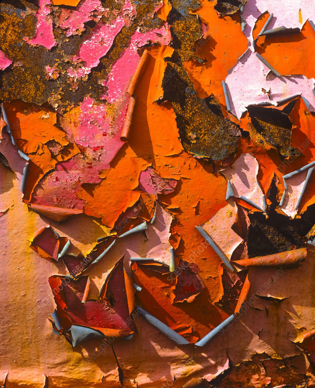 Peeling paint on rusting steel