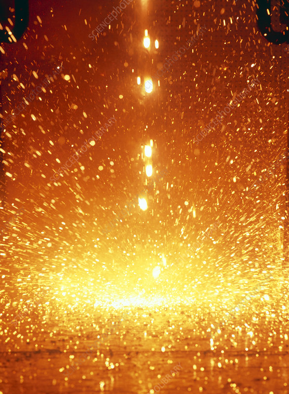 Molten steel droplets falling from test plate
