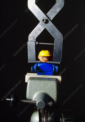 Lego toy in a vice as part of a safety test