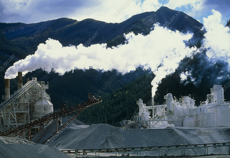 Cement works with smoke coming from its chimneys