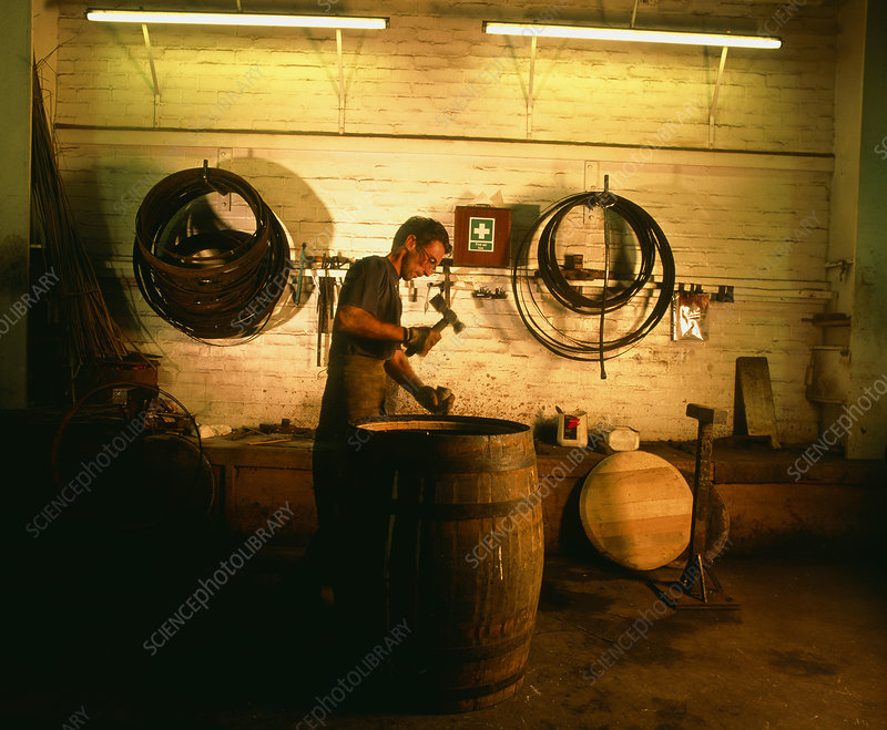 Cooper repairing a whisky cask