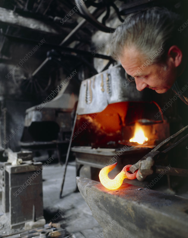Blacksmith using his anvil