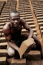 Making mud bricks, Uganda